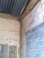 water stains the walls as it runs down inside the classrooms. Pity the roof doesn't leak.