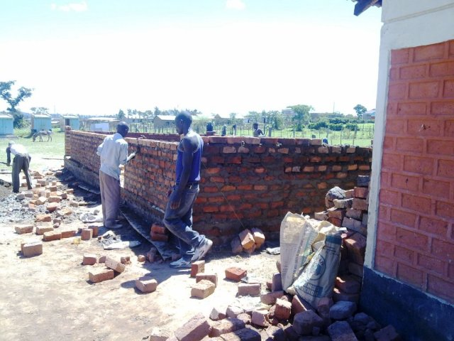Starting to build the walls of the first building of the James Murray Children's Home in Kenya